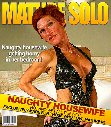Squirting red housewife playing with a banana