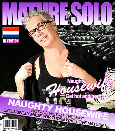 Squirting mature slut masturbating with a toy