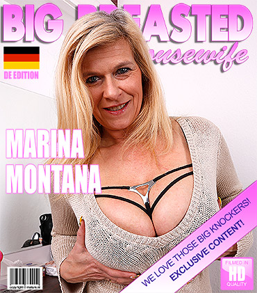 Big breasted heavily pierced German housewife masturbating